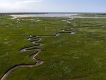 Aerial image of dutch national park the slufter with curving rivers in grass land towards the north sea on the island of Texel. Aerial image by drone of dutch stock photo