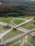 Aerial image of highway intersection. In the middle of the forests in the outskirts of the capital region of Finland stock image