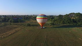 Aerial image of a hot air balloon preparing for flight. Aerial image of a hot air balloon preparing for flight in the field on summer morning stock video footage
