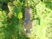 Aerial image of landscaped garden in West Sussex. The White Sea a garden water feature designed by Harold Peto which is in the grounds of Sedgwick Park House royalty free stock photography