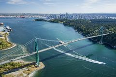 Aerial image of Lions Gate Bridge, Vancouver, BC. An aerial image of the Lions Gate bridge with ships passing underneath, Vancouver, BC in the background stock photo