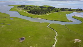 Aerial Image of Marsh Habitat in Cape Cod. Narrow channels wind through a marsh on Cape Cod, Massachusetts. Marshes and wetlands provide flood and erosion stock video footage