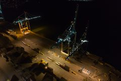 Aerial night drone photo Port Miami cranes. Aerial image of Port Miami loading cranes shot with a drone at night royalty free stock image