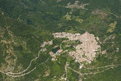 Aerial image of the village of Patrica in the Lazio region of It. Aerial image of the village of Patrica surrounded by forests in the Lazio region of Italy royalty free stock images