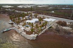 Home hit hard by Hurricane Irma Florida Keys. Aerial image of a waterfront house hit hard by Hurricane Irma Stock Images