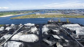 Aerial of industrial harbour with coal ores stock images