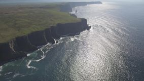 Aerial Ireland countryside tourist attraction in County Clare. The Cliffs of Moher and Burren Ireland. stock footage