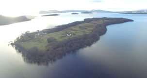 Aerial: Island in the Scottish Highlands during a beautiful clear winters day, Scotland.  stock video