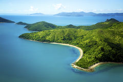 Aerial of island in Whitsundays, Queensland Austra. Lia. Beautiful mountainous island with sandy white beach and turquoise water Royalty Free Stock Images