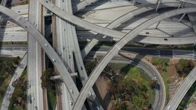 AERIAL: Judge Pregerson Huge Highway Connection showing multiple Roads, Bridges, Viaducts with little car traffic in Los