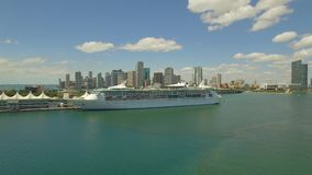 Aerial, 4K. Cruise Ship at port of Miami and skyscrapers behind it. Florida, USA stock video footage