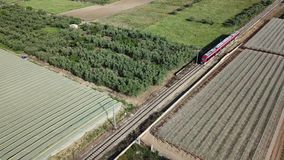 Aerial view of train over railway in the countryside. Aerial 4k drone footage of train over railway in the countryside stock video