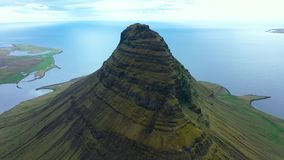 Aerial 4k drone view of Kirkjufell mountain, one of Iceland most iconic mountains on the Snaefellsnes peninsula stock footage