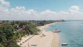 Aerial Footage of the beautiful Sanur Beach and the City in the background in Bali Indonesia stock footage