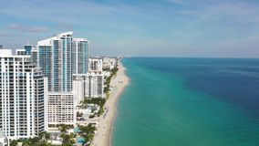 Aerial 4k footage of buildings on the beach in Miami Beach stock footage