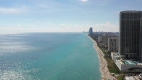 Aerial 4k footage of buildings on the beach in Miami Beach stock video