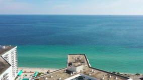Aerial 4k footage heading to pristine beach in Miami Beach stock video footage