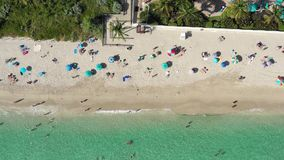 Aerial 4k footage of people  a good time on the beach in Miami beach stock video footage