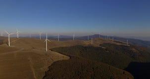 Aerial 4K Footage Of Renewable Energy Wind Turbine Farm. Aerial view of Wind turbines Energy Production- 4k aerial shot stock video