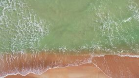 Aerial 4k footage of small waves crashing in Miami Beach stock footage