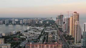 Aerial 4k Footage of Sunny Isles Beach during sunset stock video footage