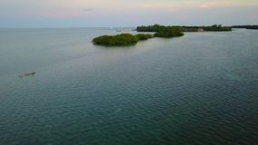 Aerial of Lagoon and Island Resort in Belize. Aerial view of a gorgeous resort on a small, remote island in Turneffe Atoll, Belize. The area supports a wide stock video footage