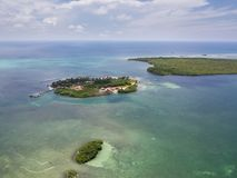 Aerial of Lagoon and Tropical Island Resort in Belize. Aerial view of a gorgeous resort on a small, remote island in Turneffe Atoll, Belize. The area supports a Royalty Free Stock Photos