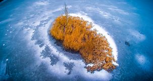 Aerial frozen lake frozen in cold winter