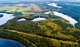 Aerial lake photography. Lakes in forest, aerial photography of beautiful Lithuanian scenic nature in autumn season Royalty Free Stock Photos