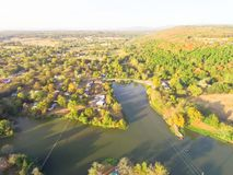 Scenic aerial view of green suburban area of Ozark, Arkansas, US. Aerial lakeside suburban area of Ozark, Arkansas, USA. Scenic view mountain residential Royalty Free Stock Photo