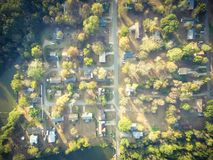 Scenic aerial view of green suburban area of Ozark, Arkansas, US. Aerial lakeside suburban area of Ozark, Arkansas, USA at sunset. Top overhead residential Royalty Free Stock Photo