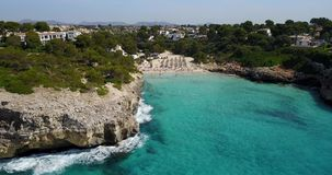Aerial landscape of the beautiful bay of Cala Anguila with a wonderful turquoise sea. Porto Cristo, Majorca, Spain stock video footage