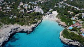 Aerial landscape of the beautiful bay of Cala Anguila with a wonderful turquoise sea. Porto Cristo, Majorca, Spain stock footage