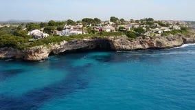 Aerial landscape of the beautiful bay of Cala Anguila. With a wonderful turquoise sea, Porto Cristo, Majorca, Spain stock video footage