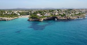 Aerial landscape of the beautiful bay of Cala Anguila with a wonderful turquoise sea. Porto Cristo, Majorca, Spain stock video