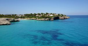 Aerial landscape of the beautiful bay of Cala Anguila. With a wonderful turquoise sea, Porto Cristo, Majorca, Spain stock video