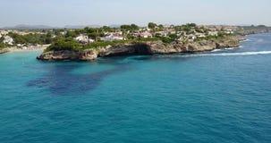 Aerial landscape of the beautiful bay of Cala Anguila. With a wonderful turquoise sea, Porto Cristo, Majorca, Spain stock footage