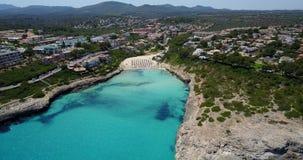 Aerial landscape of the beautiful bay of Cala Mandia. With a wonderful turquoise sea, Porto Cristo, Majorca, Spain stock footage