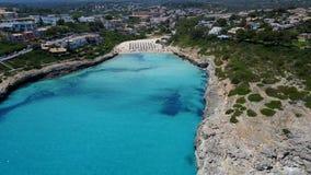 Aerial landscape of the beautiful bay of Cala Mandia. With a wonderful turquoise sea, Porto Cristo, Majorca, Spain stock video