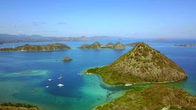 Aerial landscape of beautiful tropical island. Aerial landscape footage of beautiful tropical island with turquoise water in East Nusa Tenggara, Indonesia. Shot stock video