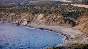 Aerial landscape coastline at sea beach on background green hill. Panoramic view sea water splash on rocky coast. Drone view from above on wild beach stock video
