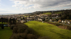 Aerial Landscape. An aerial landscape containing green fields in the foreground leading into housing structures Stock Image