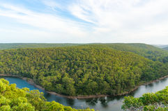 Aerial landscape of forest and river. Aerial landscape of beautiful eucalyptus forest and river bend of Hacking river. Bungoona Lookout, Royal National Park Stock Photo