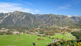 Aerial landscape with green meadow in Alpine valley. Aerial landscape with fresh green grazing meadow in Bavarian Alpine valley Royalty Free Stock Photography