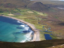 Aerial Landscape Of Hoy Island. Hoy Island, part of Orkney Islands in Scotland, from an aerial view; showing turquoise bay, highlands, meadows, and beach line stock photo