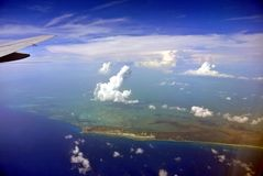Aerial landscape. Indonesian islands from plane view royalty free stock photo