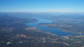 Aerial landscape of Lake Maggiore in Italy from the airplane window royalty free stock image