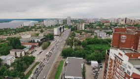 Aerial landscape of modern city in Russia near Volga river, modern and soviet buildings, traffic jam. In summer day, old building of communal kitchen stock video