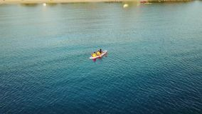 Aerial landscape of people canoeing on the sea stock video