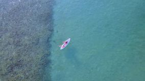 Aerial landscape of people kayaking on the sea stock video footage